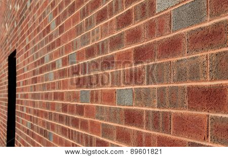 Long brick wall withdoor opening near end
