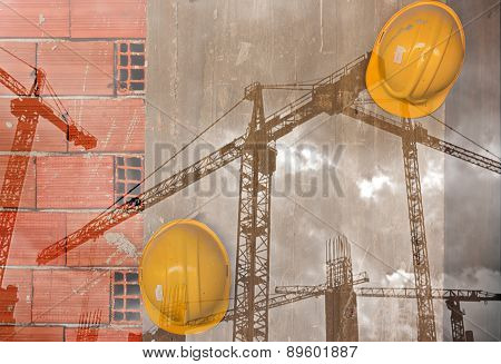 Double exposure image of tower cranes and builders hard hat