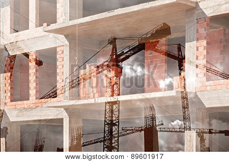 Double exposure image of tower cranes and working construction site
