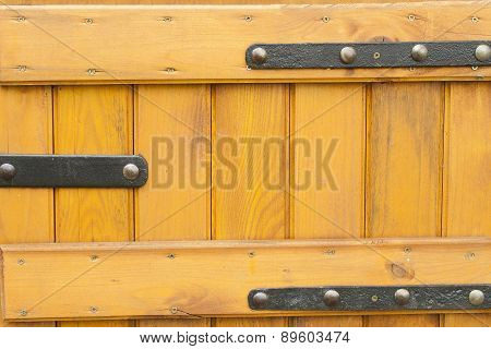wooden doors with wrought iron