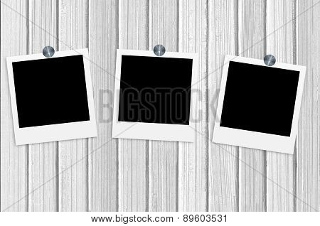 Blank Old Photos On Clips On White Wooden Background