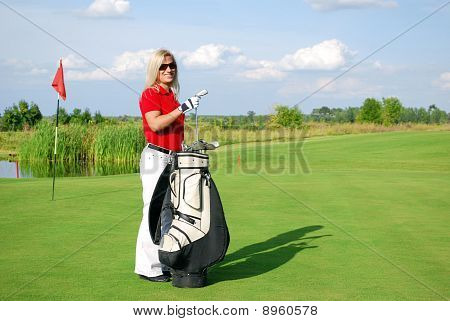 girl golf player with golf bag