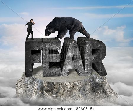 Businessman Against Black Bear Standing On Fear 3D Concrete Word