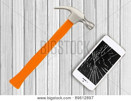 Modern Broken Mobile Phone And Hamster On White Wooden Background