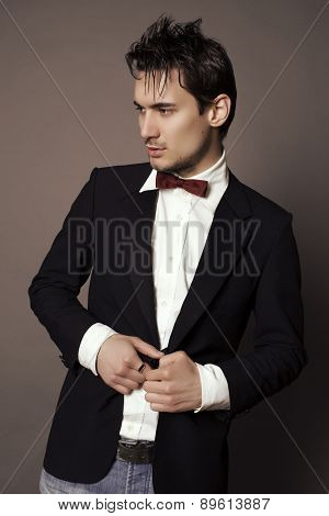 Handsome Businesslike Man With Dark Hair In Elegant Suit