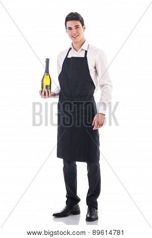 Young chef or waiter holding green champagne bottle