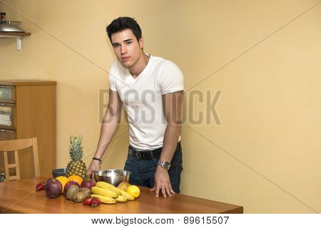 Young man preparing a fruit smoothie