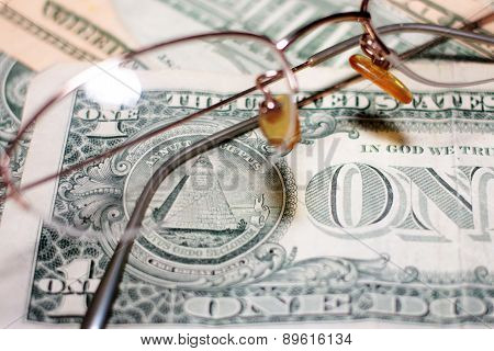 glasses and dollars