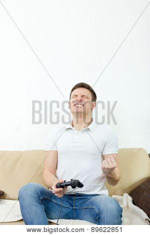 Man Playing Video Games With Joypad Or Joystick To Console Or Pc