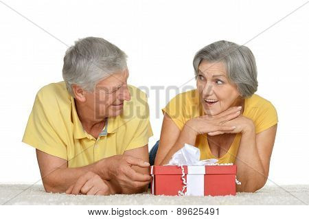 Happy older couple with gift