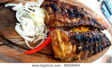 Spare Ribs In Wooden Tray With Vegetables