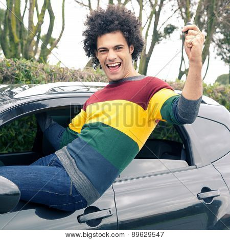 Happy Smiling Man With New Car Holding Key