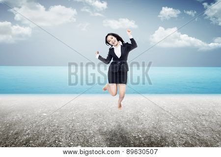 Woman Jumping On The Beach