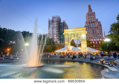 NEW YORK CITY - SEPTEMBER 12, 2012: Crowds gather at Washington Square Park. The historic park is popular in the summer.