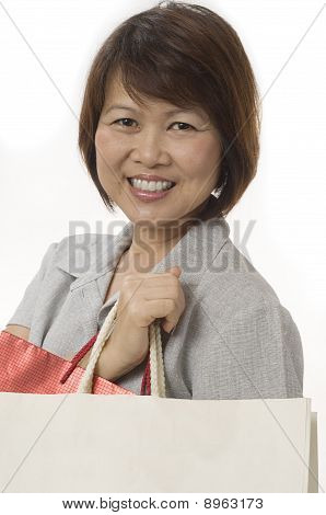 Asian Woman With Shopping Bags And A Nice Smile