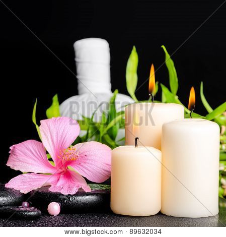 Spa Setting Of Hibiscus Flower, Twig Bamboo, Thai Herbal Compress Balls, Beads And Candles On Zen Ba