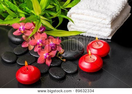 Spa Still Life Of Blooming Twig Red Orchid Flower, Phalaenopsis, Bamboo With Dew, Towels And Candles