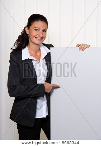 Successful Young Businesswoman With An Empty Poster