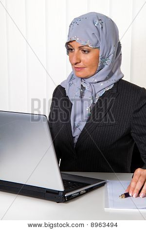 Example Picture Islam. Muslim, Woman With A Headscarf In The Office