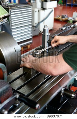 Laborer Using A Wrench To Rotate A Metallic Piece