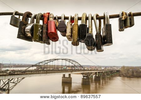 Locked Padlocks And A Bridge Construction
