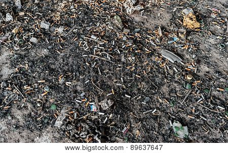 Discarded Cigarette Butts And Stubs In Dirty Floor