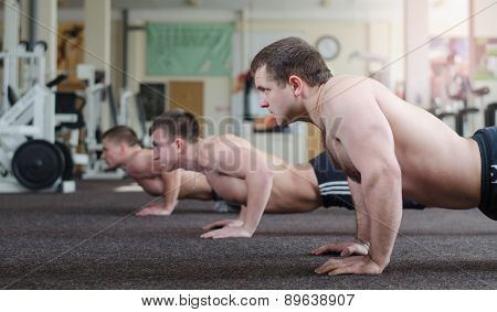 Athletes Push-ups From The Floor