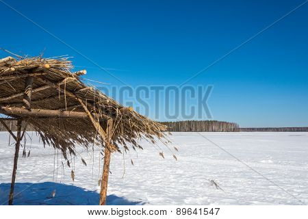 Thatched Roof With The Snow.
