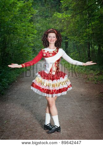 Young Woman In Irish Dance Dress And Wig Welcoming