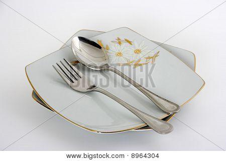 utensils, plates, forks, spoons