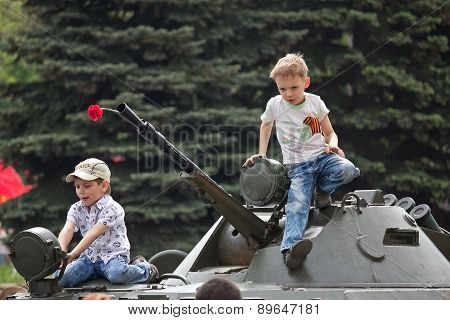 Makeevka, Ukraine - May, 9, 2012: Children On An Armored Vehicle During A Parade In Celebration Of T