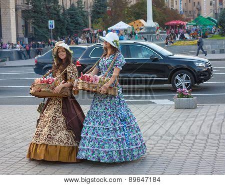 Ukraine, Kiev - September 11,2013: Girls In Historical Costumes Sell Sweets For Tourists
