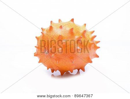 Melano or kiwano melon on white background