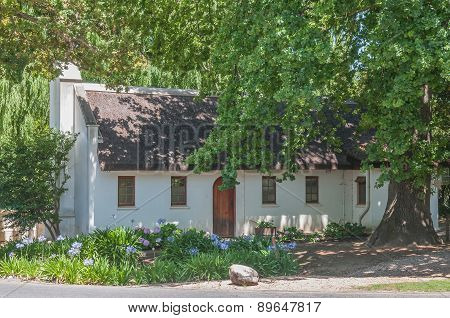 Historic House Under Old And Big Oak Tree