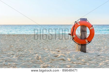 Life Preserver On Sandy Beach