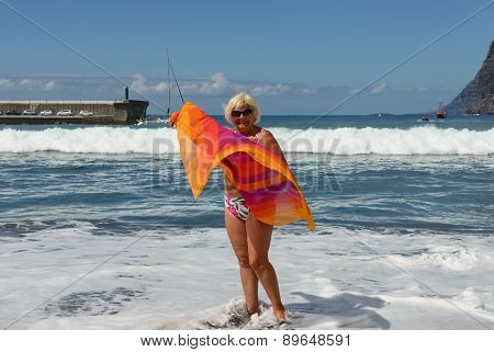 Aged Woman On Surf Waves Background.