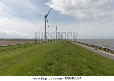 Wind Farm Along The Dike Of The Noordoostpolder