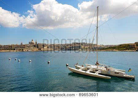 The View On Valletta And Sail Yacht With Ukrainian Flag In Sunset, Sliema, Malta