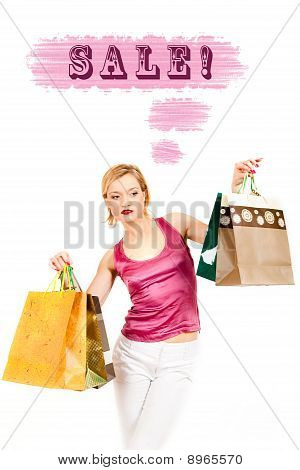 Young Pretty Shopping Woman With Lots Of Bags And Sale Word Above