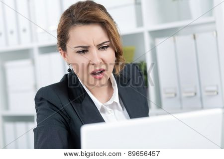 Portrait Of Amazed Young Business Woman