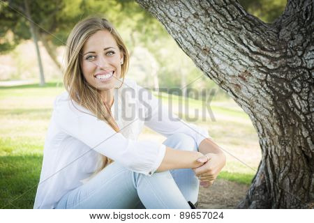 Portrait of a Beautiful Young Woman Outdoors at the Park.