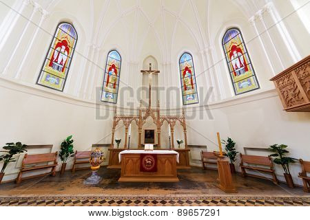 MOSCOW - JUNE 9, 2014: Baroque altar and stained glass windows in the Cathedral of St. Peter and Paul