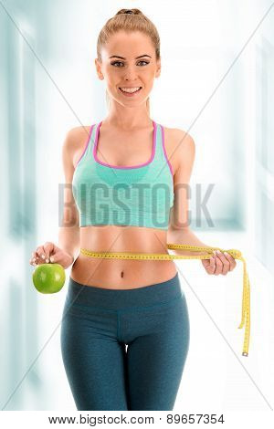 Young Woman Measuring Herself. Weight Loss