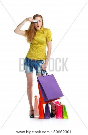 Shopaholic Woman With Shopping Bags And Credit Card Over White