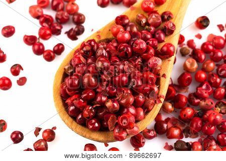Red Peppercorns In Wooden Spoon Isolated