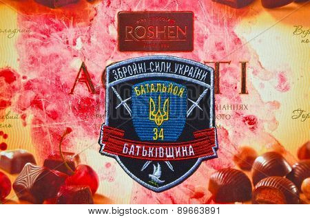 Illustrative editorial. Chevron of Ukrainian nationalist formations. With logo Roshen Inc. Trademark Roshen is property of ukrainian president Poroshenko.on April 16,2015 in Kiev, Ukraine