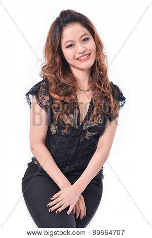 Young beautiful woman wearing black dress sitting