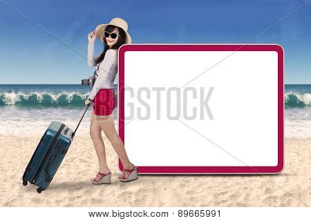 Beautiful Tourist With Signboard At Beach