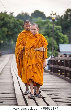 Sangkhlaburi, Kanchanaburi, Thailand - January  12, 2015: Buddhist monks walk on Bamboo Bridge the Sangkhlaburi River, Kanchanaburi, Thailand.