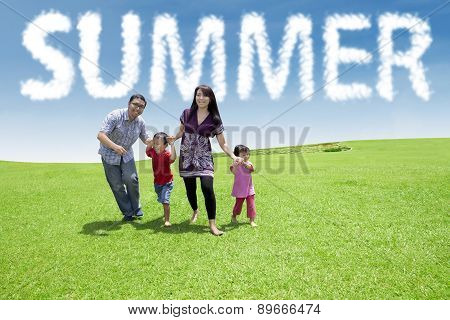Carefree Family Enjoy Leisure Time At Park